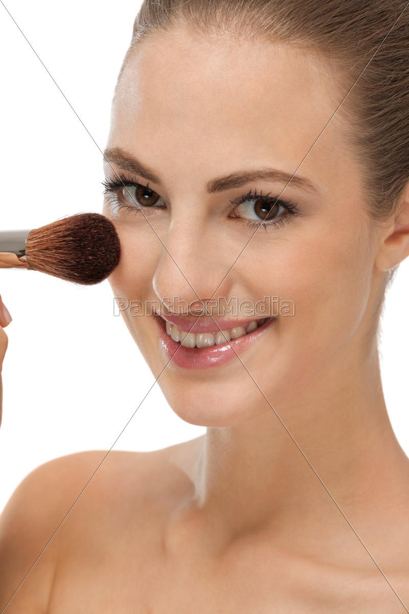 Junge frau wird geschminkt makeup puder lizenzfreies foto lizenzfreies foto 9771788 junge frau wird geschminkt makeup puder thecheapjerseys Images