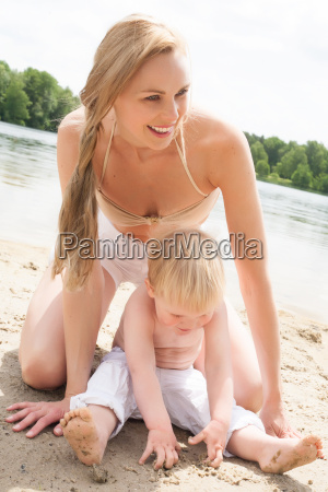 mother and son writing in sand