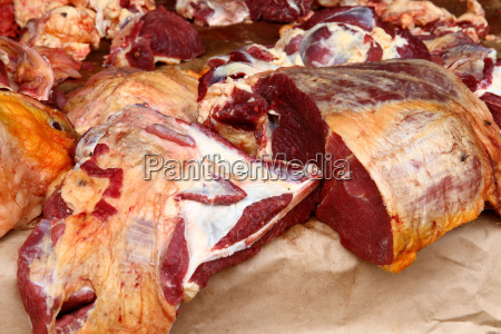 pieces of raw meat on open