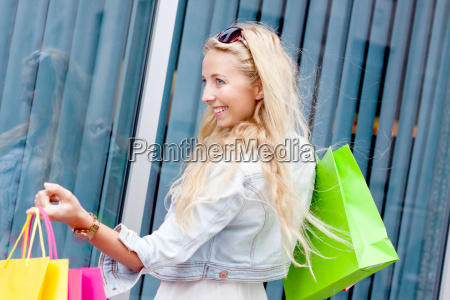 shopping bags young laughing blond woman