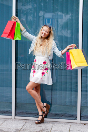 young laughing blond woman with colorful