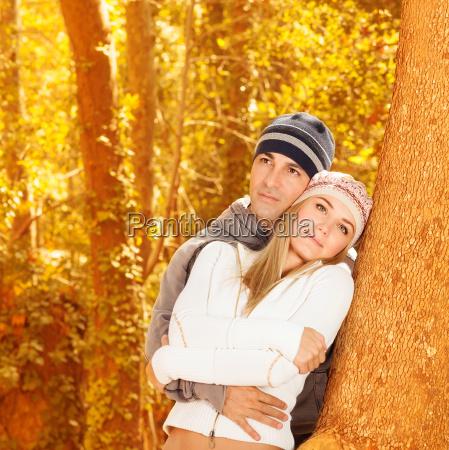 happy couple in autumn woods