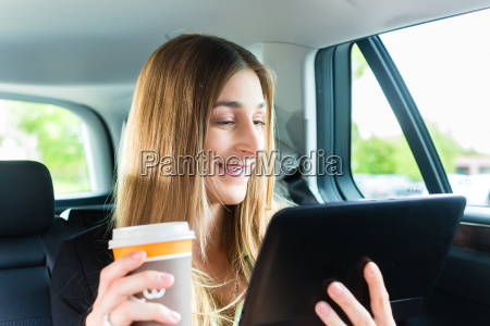 woman is driving in taxi with