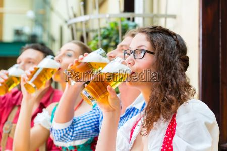 friends in bavaria drinking beer in