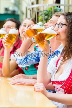 friends in bavaria drink beer in