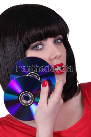 sexy girl with cds on white