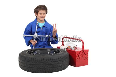little boy dressed as mechanic