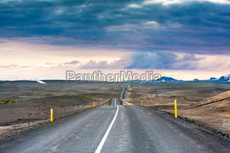 ondulated and empty road in the