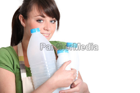 young woman carrying empty bottles of