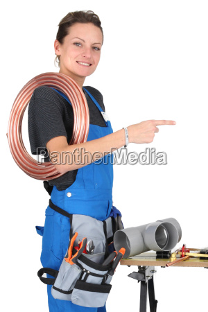 female plumber pointing