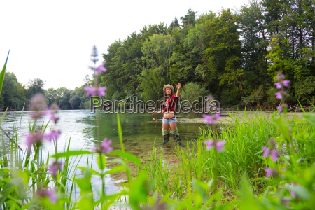 young woman fly fishing