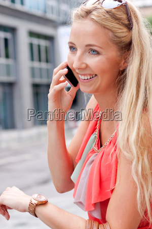 young attractive blonde woman with purse