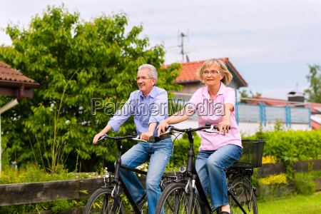 seniors playing sports with bicycle