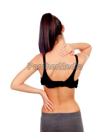 frau in der sportkleidung mit rueckenschmerzen