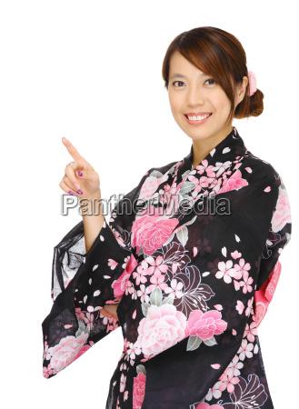 asiatische, frau, mit, kimono, und, zeigt - 10018760
