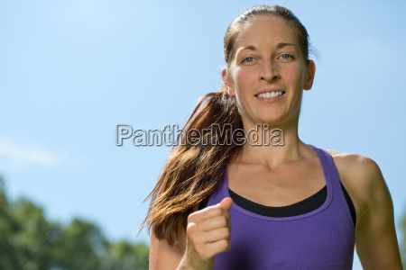 young woman while running jogging training