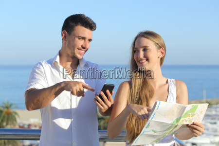 couple discussing map or smartphone gps