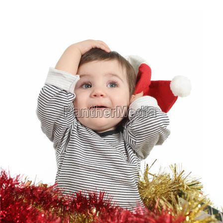 pretty baby girl holding a santa