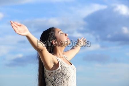 beautiful arab woman breathing fresh air