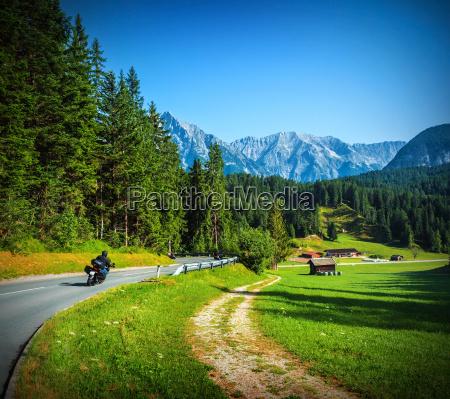 bikers on mountainous road