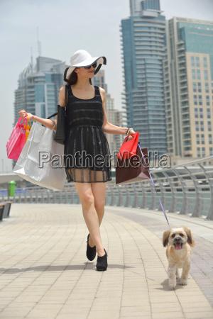 beautiful woman goes in shopping