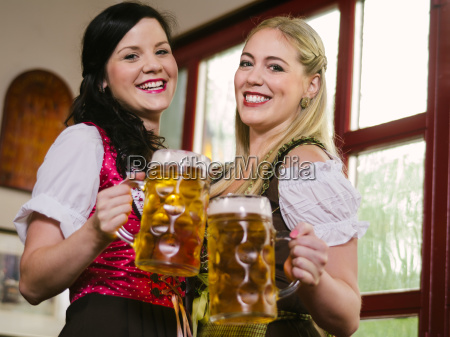 gorgeous oktoberfest waitresses with beer