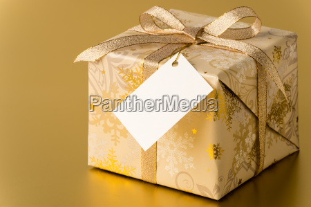 christmas present with gold ribbon and