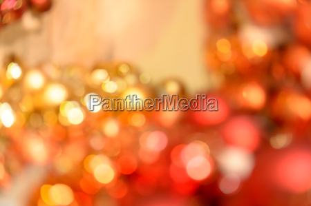 blurred red and gold christmas baubles