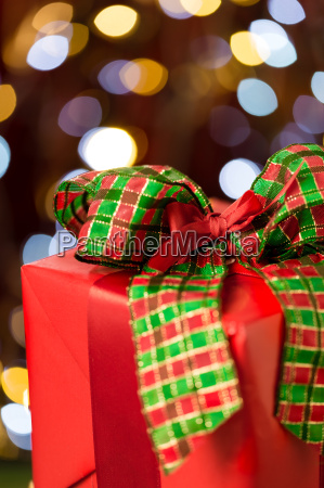 traditional red christmas present with bow
