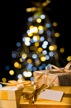 christmas tree and wrapped presents with