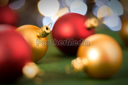gold and red christmas baubles on