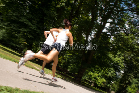 young couple jogging motion blurr