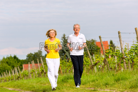 seniors jogging in the country