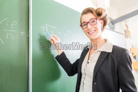 teacher writes in the classroom