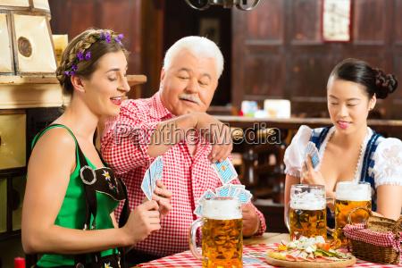 wirtshaus friends drinking beer in