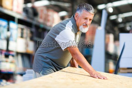 senior man buying construction wood in