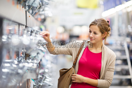 pretty young woman choosing a bathroomkitchen