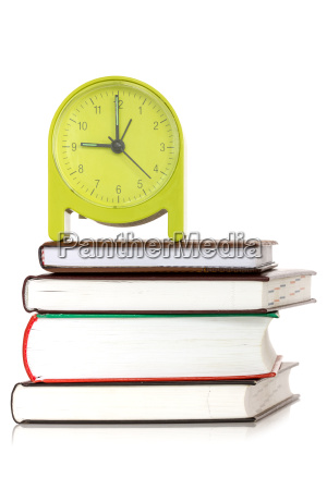 green clock and books