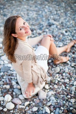 young woman on the beach enjoying