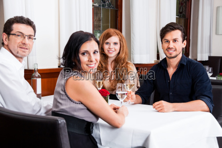 mixed group of people laughing in