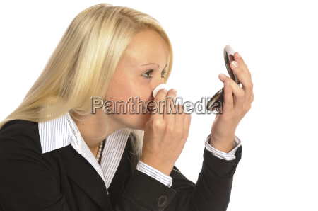 young woman is doing make up