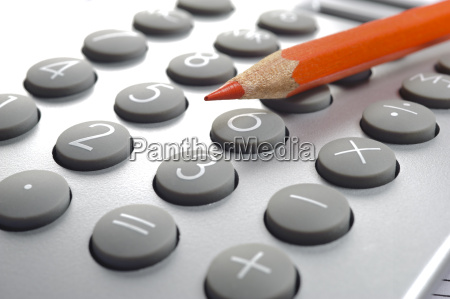 calculation with calculator and red pencil