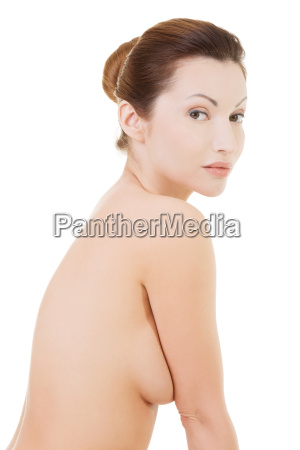 naked woman sitting side view
