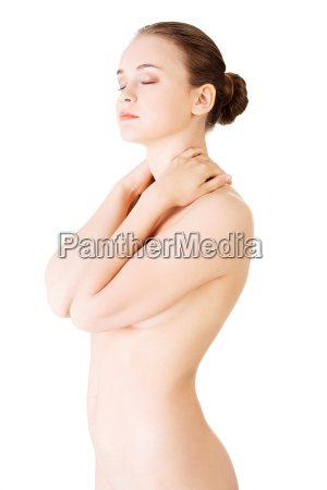 attractive naked woman touching her neck