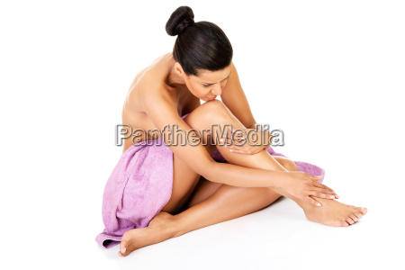 attractive naked woman sitting with towel