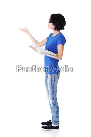 attractive woman with workbook side view