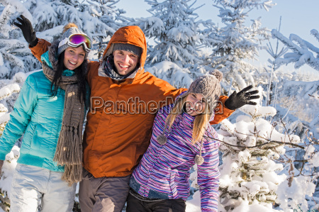 friends enjoy winter holiday break snow