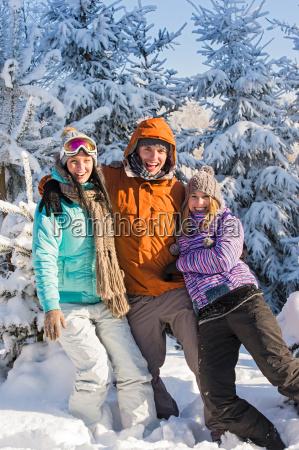 three friends enjoy snow winter holiday