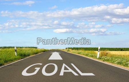 goal concept with arrow on street