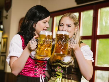 beautiful women drinking oktoberfest beer